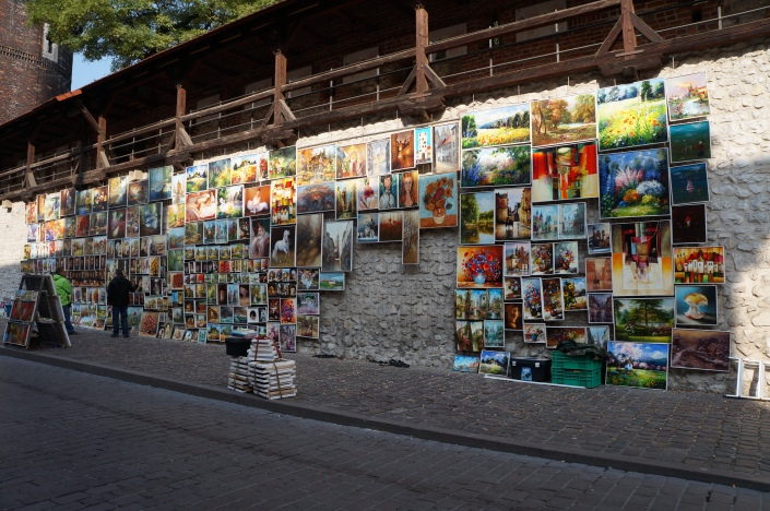 Street artists displaying their canvases