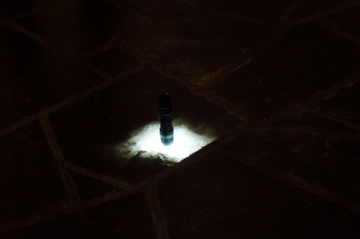 Lighted torch placed on the floor made out of salt