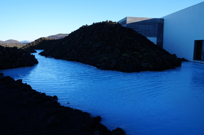 A sneak peek of the blue water can be seen from the outside of the facility